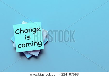 CHANGE IS COMING - motivation note at blue background with empty space for text, template and mockup.