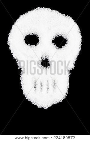 unhealthy white sugar concept-spilled white sugar crystals forming a skull.