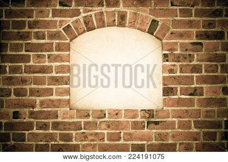 Old stone arch arc niche with space for text frame in brick wall background