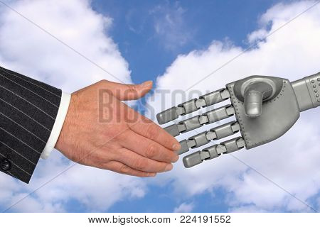 Handshake between a businessman and robotic hand, a meeting with technology concept.