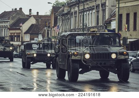 Brasov, Romania - May 14, 2015: American convoy of troops and wheeled armored vehicles pass through Brasov city on their way to Cincu to take part in an international drill.