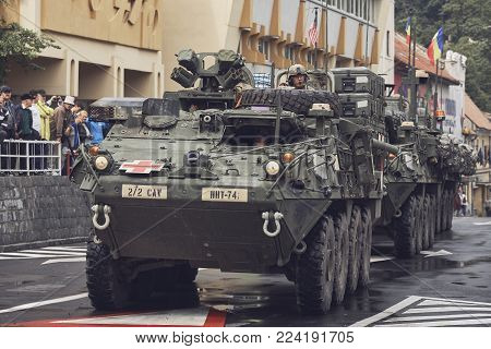 Brasov, Romania - May 14, 2015: American convoy of troops and heavy armored vehicles march through Brasov city on their way to Cincu to take part in an international drill.