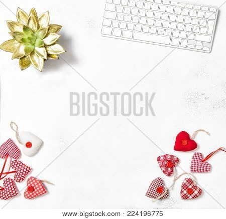 Office desk flat lay for social media. Valentines day. Keyboard, succulent and red hearts on white background