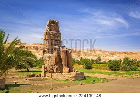 The Colossi of Memnon, two massive stone statues of Pharaoh Amenhotep III near Luxor, Egypt