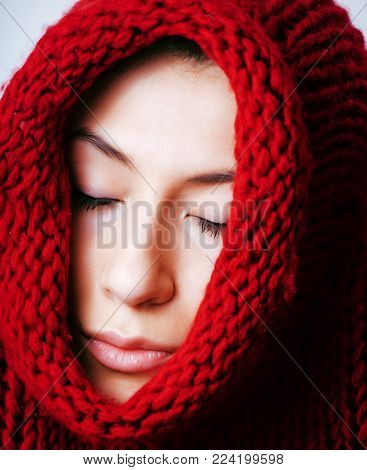 young brunette gloomy woman in sweater all over her face, messed hair close up, lifestyle winter people concept