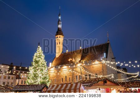 Traditional Christmas Market On Town Hall Square. Christmas Tree And Trading Houses With Sale Of Christmas Gifts, Sweets And Mulled Wine. Famous Landmark.