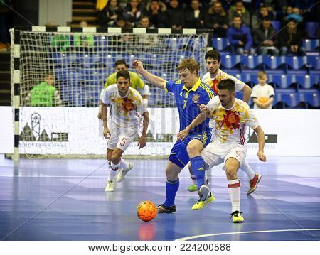 KYIV, UKRAINE - JANUARY 29, 2017: Mykola Grytsyna of Ukraine (#7) fights for a ball with Alex Yepes of Spain (#9) during their Friendly Futsal match at Palats of Sports in Kyiv, Ukraine