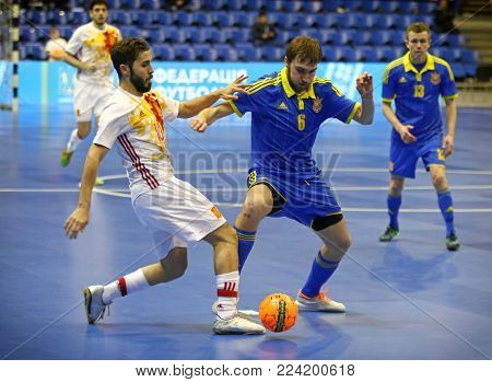 KYIV, UKRAINE - JANUARY 29, 2017: Rafa Usin of Spain (L) fights for a ball with Volodymyr Razuvanov of Ukraine during their Friendly Futsal match at Palats of Sports in Kyiv, Ukraine