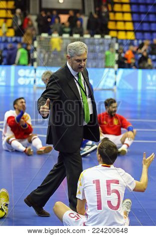 KYIV, UKRAINE - JANUARY 29, 2017: Head Coach of Spain National Team Jose Venancio Lopez Hierro thanks to their players after the friendly Futsal match against Ukraine at Palats of Sports in Kyiv