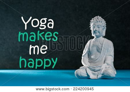 figurine of buddha practicing yoga or meditate. Yoga class or studio concept. Sense of Freedom. Calmness and relax, happiness.