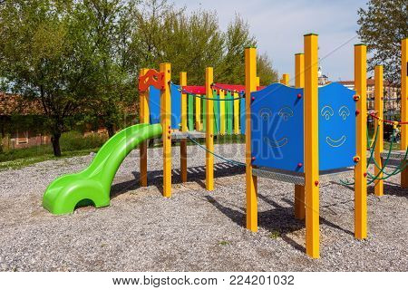 Colorful children playground in urban park.