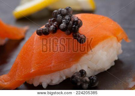 Nigiri Sushi With Fresh Salmon And Black Caviar