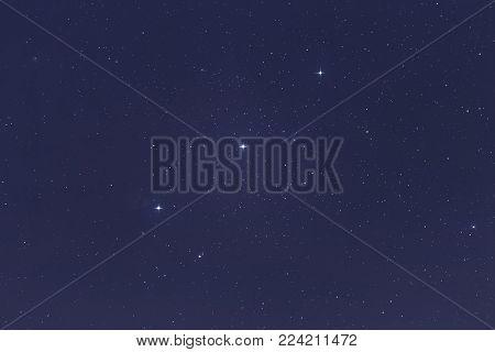 Orion's Belt with Alnitak, Mintaka, Alnilam stars. Night sky Background.