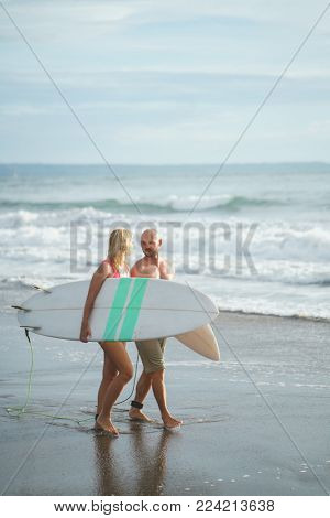Young couple with a surfboards outdoots