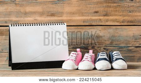 Selected due date in the calendar and detail of baby shoes