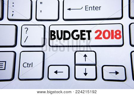 Word, writing Budget 2018. Business concept for Household budgeting accounting planning written on white keyboard key with copy space. Top view