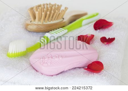 toothbrush hairbrush and soap of health care on white