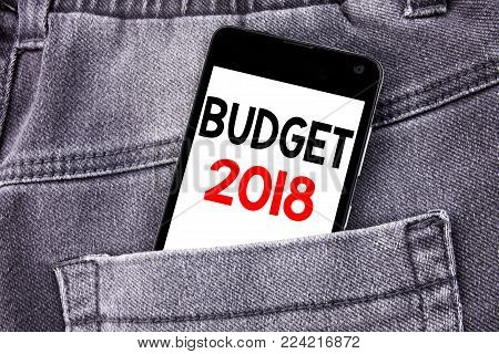 Conceptual hand writing text caption showing Budget 2018. Business concept for Household budgeting accounting planning written mobile cell phone with space in the back pants trousers pocket