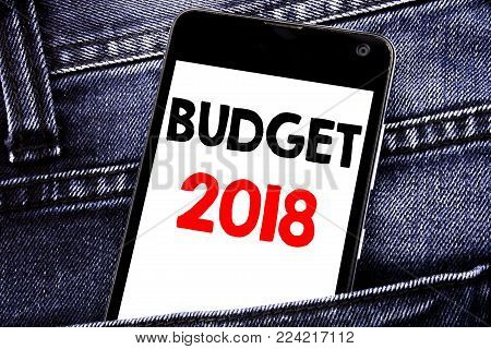 Writing text showing Budget 2018. Business concept for Household budgeting accounting planning written mobile cell phone with space in the back pants trousers pocket