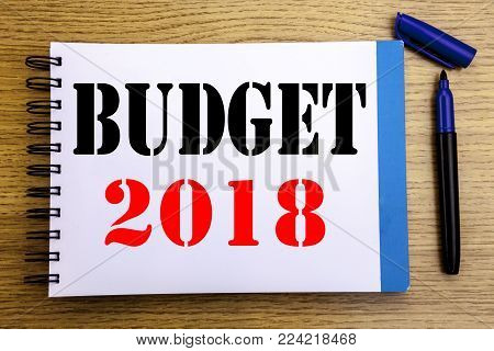 Handwriting Announcement text showing Budget 2018. Business concept for Household budgeting accounting planning Written on notepad paper background with space office view with pencil marker