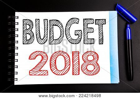 Handwritten text showing Budget 2018. Business concept writing for Household budgeting accounting planning Written on notepad paper, black background with space office view with pencil marker