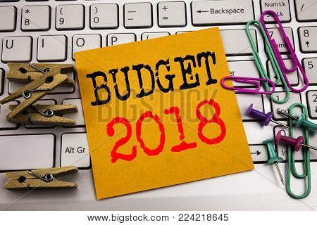 Writing text showing Budget 2018. Business concept for Household budgeting accounting planning written on sticky paper on the white keyboard background.
