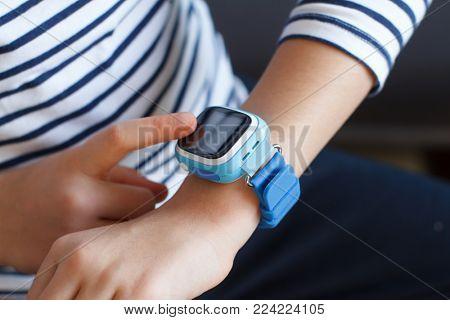 School girl looking at her smartwatch phone