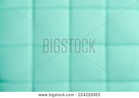 Closeup of blue silicone mold for baking using as background