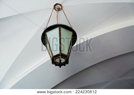 Ð?ld fashioned outdoor lamp on white ceiling with arhitecture detail. Mijas town. Spain