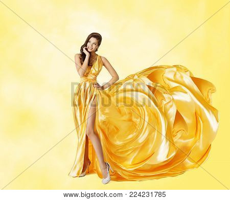 Woman Yellow Dress, Happy Fashion Model in Elegant Long Gown, Flying Artistic Waving Silk Tail