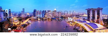 Panorama of Singapore city skyline at sunset, aerial view. Singapore business district with skyscrapers at twilight. Popular travel destination.