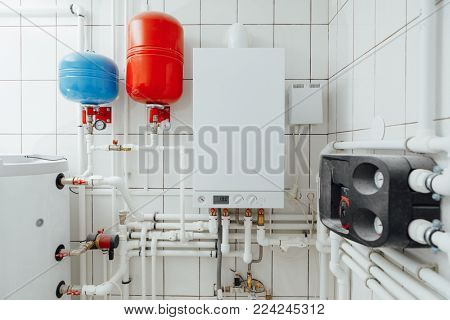 modern independent heating system in boiler room