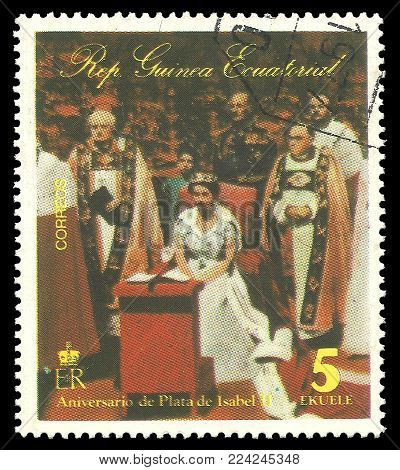 Guinea Equatorial - circa 1977: Stamp printed by Guinea, Color edition on 25th Coronation Anniversary, shows Queen Elizabeth II at a public occasion, circa 1977