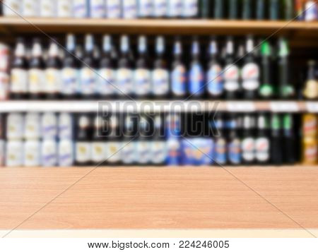 Wooden Counter Product Display With Beer Bottle On Shelf, Blurred Background
