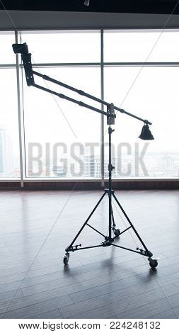 Lightweight camera crane mock up view with window background. Black color.