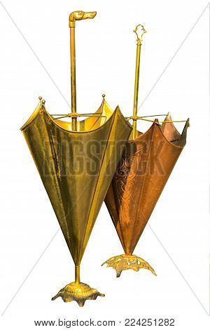 Two umbrella stands in copper and brass with isolated white background and clipping path.