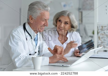 Portrait of doctor and famale patient in office
