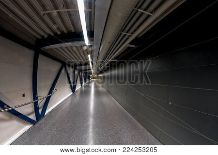A tunnel leading from one gate to another at the airport of Helsinki, the capital of Finland. The airport has a very industrial look.