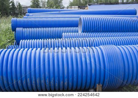 Blue corrugated pipe for electrical high-voltage cables isolated on white background
