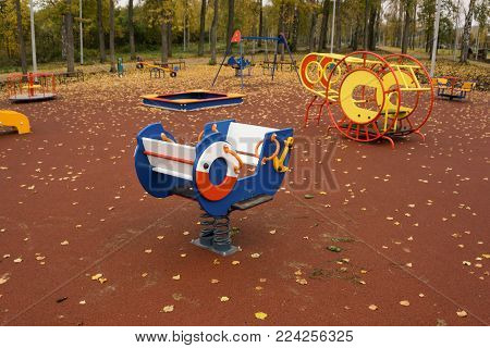 Outdoor children playground in sunny day seesaw set