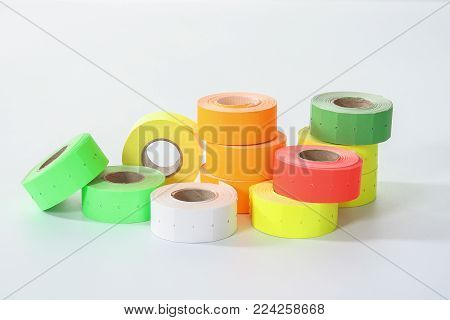 Colored Commercial Stickers In Rollers. Double Scotch Tape.