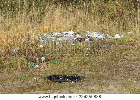 Garbage dump on green meadow utilize, wild - Russia Berezniki 11 Oct 2017 .