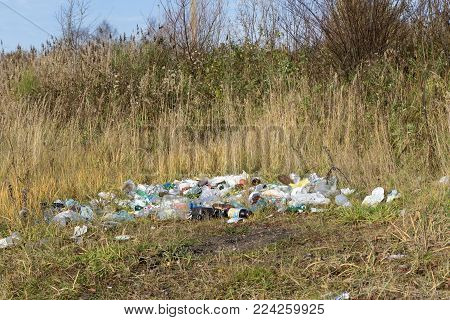 Plastic contamination into nature. Trash and bottles floating on the water. Environmental pollution in Russia - Berezniki on 10 October 2017