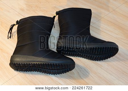 Tall women's autumn winter boots above the knee. They are standing in the studio on a white background. Boots with zippers. Color is blue. The material is leather