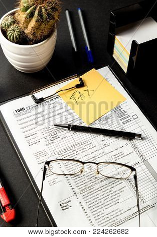 It`s time for taxes. US tax forms 1040 ready for completion.