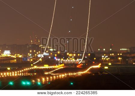 Long shot of plane taking off, long exposure with light trail, rear view