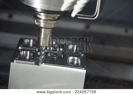 The CNC milling machine cutting the sample part.The flat end-mill tool cutting the mold part by CNC milling machine.