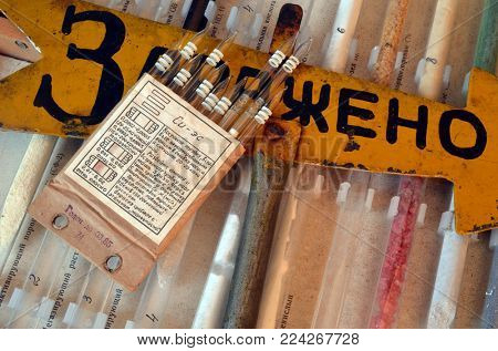 ILLUSTRATIVE EDITORIAL.Test tubes for military set danger agents measurment.Vintage Soviet military educational set - Warfare agents of NATO.Sign CONTAMINATED (RUS).January 22,2018,Kiev, Ukraine