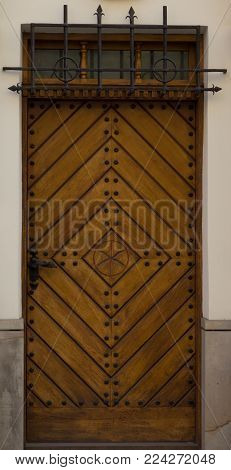 The vintage yellow  wooden front door of an old house-4