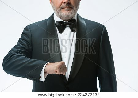 The senior waiter holding white towel and standing isolated on white studio background. sign language in the restaurant. Gesture means - tap water cleaned water should be served